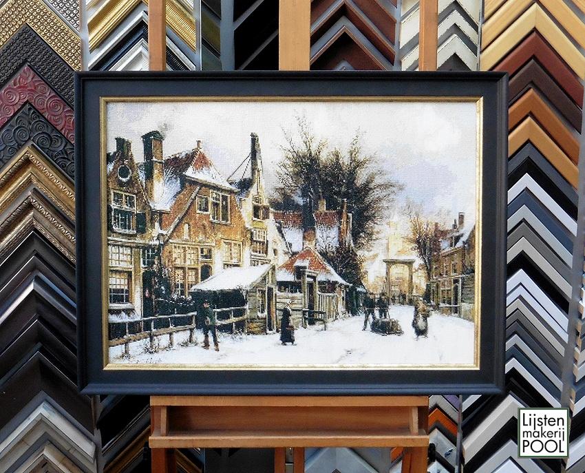 """Borduurwerk """"Stad in de winter"""" op draad gespannen"""